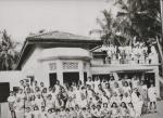 Issadeen family women with some  men. Most of them are dead .The photo was  taken in 1947 at No 80 Meera Road, Issadeen Town. This old building  in the background remains the same without any change to date